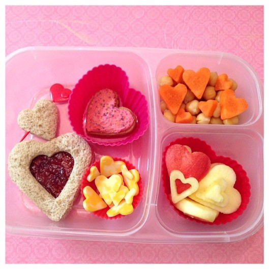 Cream and jelly sandwich, cheese, apples, carrots, chickpeas, and a homemade cookie w/ homemade frosting. Of course, everything is heart-shaped!