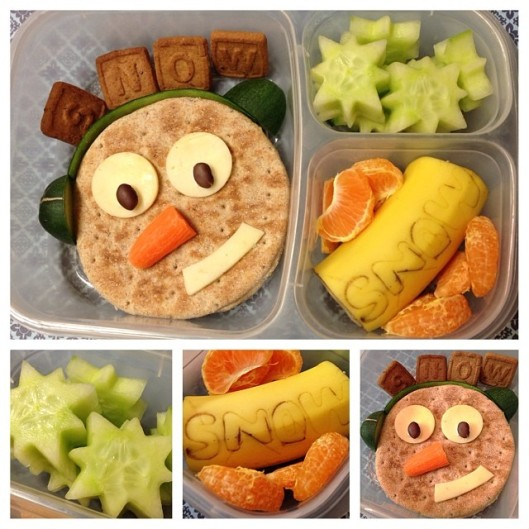 "Cream cheese/jelly sandwich, cucumber (snow-shaped), banana (w/ the word snow on it), clementines, and letter cookies to spell out ""snow"""
