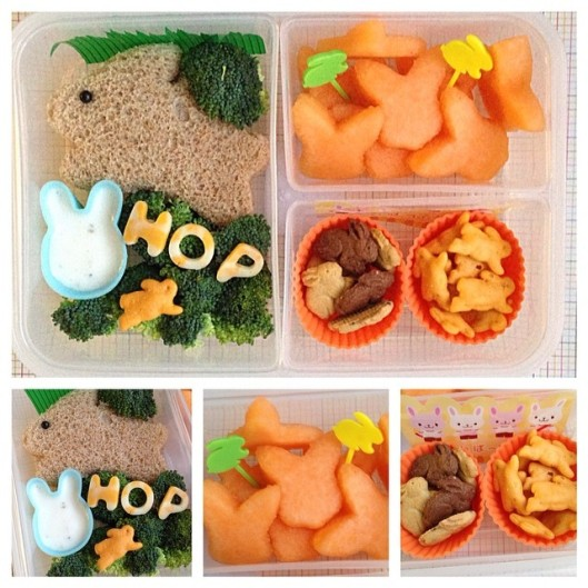 Bunny sandwich, surrounded with broccoli and some ranch dip in a bunny silicone cup, cheese spelling the word HOP, bunny shaped cantaloupe with bunny food picks, organic wheat bunny cheese crackers and cookies.