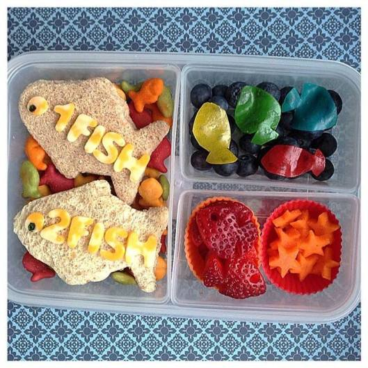 One Fish, Two Fish, Red Fish, Blue Fish, by Dr. Seuss: Sandwiches on top of colored goldfish crackers, blueberries with fish cut out from fruit leather, fish-shaped strawberries, and star-shaped carrots.