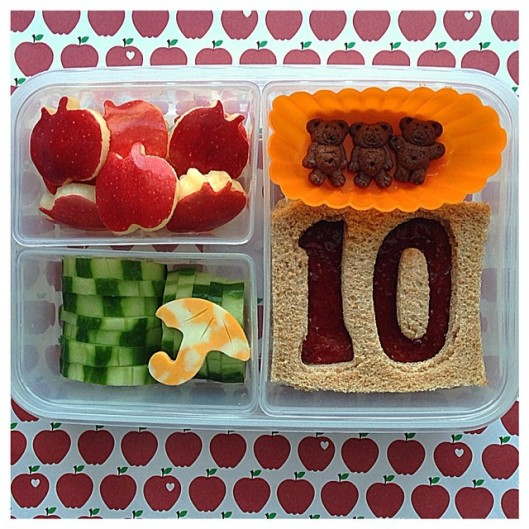 Ten Apples Up on Top by Dr. Seuss:  Jelly sandwich, chocolate bears, cucumbers, umbrella-shaped cheese, and 10 apple-shaped apples.